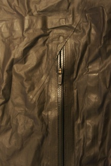 Detail of the PU coated zippered hand pocket. Note the texture of the jacket and how evident the tapped seams are.