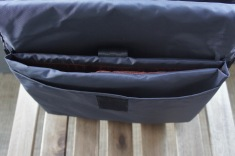 One of the document pockets can be secured with the laptop strap. The other is an open top for easy access.